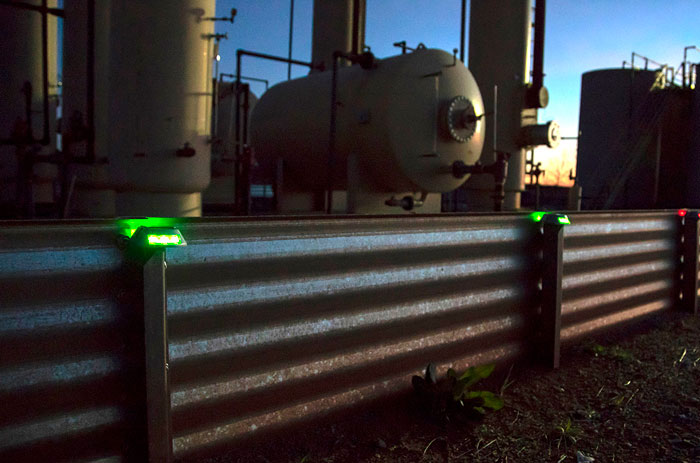 Lights on oil field fencing